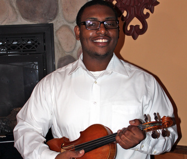 Vincent Neil was the 2014 award recipient of the Bayonne Historical Society's leadership in community service scholarship program.