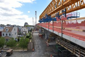 The rolling gantry crane on top of the completed first span of the new roadway for the Bayonne Bridge. Reena Rose Sibayan | The Jersey Journal